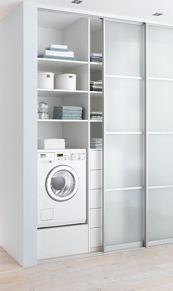 white-modern-laundry-with-sliding-door